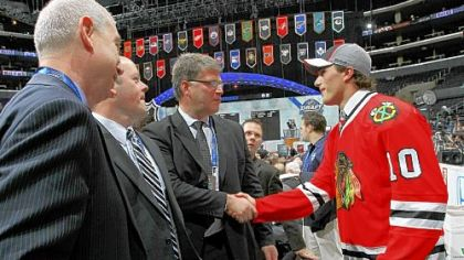 Stephen Johns of Wampum, Pa., is welcomed to the Stanley Cup champion Chicago Blackhawks being selected in the second round of the NHL draft Saturday in Los Angeles.