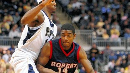 Pitt's Gilbert Brown guards Robert Morris' Gary Wallace, right, in Pitt's 92-72 victory on Feb. 2, 2009.