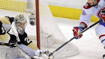 Marc-Andre Fleury makes a save on the Canadiens' Maxim Lapierre in the first period of Game 5 Saturday at Mellon Arena.