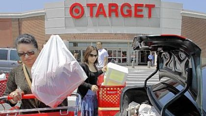 Shoppers load packages into their car after shopping at a Target. A monthly consumer survey shows that Americans' confidence in the economy eroded further in July amid job worries.