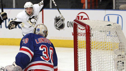 Rangers goaltender Henrik Lundqvist watches the puck as Penguins Chris Conner celebrates a goal during the first period.