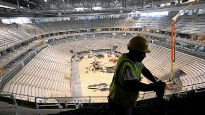 Joe Thompson of Homestead installs seats in the upper level of the new Consol Energy Center.