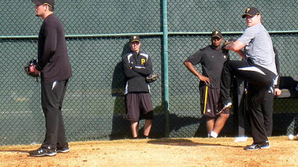 Pirates relievers Joel Hanrahan, left, and Evan Meek work off the mounds Wednesday at Pirate City in Bradenton, Fla. In the background are Jeff Karstens and Donnie Veal.