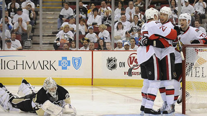 Penguins goaltender Marc-Andre Fleury lies on the ice as Senators forward Chris Neil, left, Chris Kelly, center and Jarkko Ruutu celebrate a second period goal Wednesday at Mellon Arena.