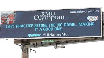 A billboard along the Parkway West shows the first tweet by Brianne McLaughlin, a Robert Morris University student and a goalie for the U.S. women's hockey team at the Winter Olymics in Vancouver. Lamar Advertising sold the billboard space to the university.