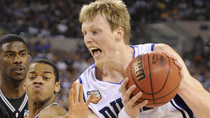 Duke's Kyle Singler drives to the net against Butler's Ronald Nored in the first half.