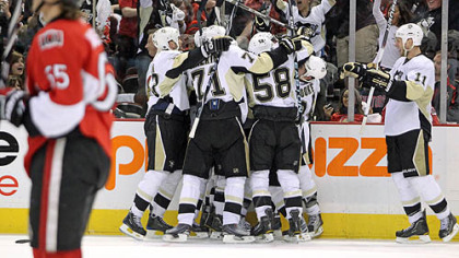 The Penguins celebrate forward Pascal Dupuis' overtime goal in Saturday's game at ScotiaBank Place in Ottawa.