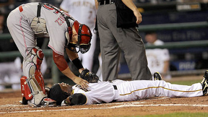 Reds catcher Ramon Hernandez checks on Andrew McCutchen after he was hit by a pitch Tuesday.