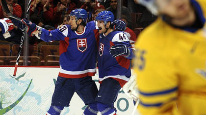 Slovakia defenseman Andrej Sekera, right, celebrates with teammate Richard Zednik following a goal Wednesday night.