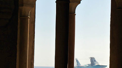 Crystal Serenity as seen from the port of Malaga, Spain. Top: Upper decks offer afternoon tea with a view.