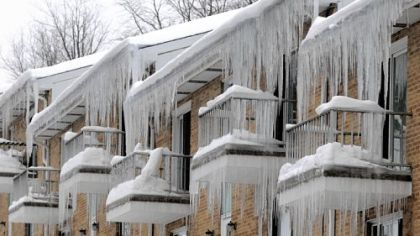 Heavy ice hangs from an apartment building in Crafton.