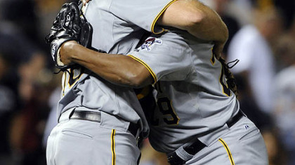 Pirates catcher Erik Kratz gives a hug to relief pitcher Octavio Dotel after beating the Rockies, 4-2.