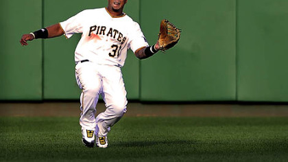 Pirates center fielder Jose Tabata makes a sliding catch on a ball hit by the Brewers' Jim Edmonds.