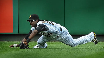 Left fielder Lastings Milledge dives but can't make the catch on a ball hit by the Giants' Juan Uribe for a run-scoring single in the ninth inning Sunday at PNC Park.