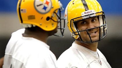 Steelers quarterback Ben Roethlisberger shares a laugh with Byron Leftwich during practice at the team's facility on the South Side Wednesday.