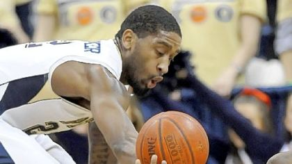 Pitt guard Brad Wanamaker looks for a steal as Robert Morris guard Velton Jones hits the floor in the first half.