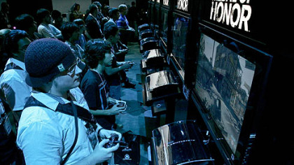 "Attendees at the Electronic Entertainment Expo in Los Angeles try out the Electronics Arts' ""Medal of Honor"" game."