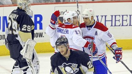 Penguins goaltender Marc-Andre Fleury watches the puck enter the goal during the second period.