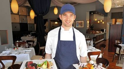 Sous chef Dan Carlton of Nine on Nine Restaurant, Downtown, with prime strip steak, left, and ricotta fritters.