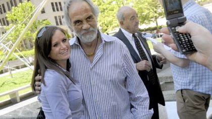"Sissy Dillon, 27, of Oakdale, has her picture taken with comedian Tommy Chong at Mellon Square in Downtown on Wednesday. Mr. Chong was in town for his show, ""Laugh 'til You're Blue,"" presented by the Allegheny County Democratic Committee. In the background  is Cyril Wecht, the former coroner."