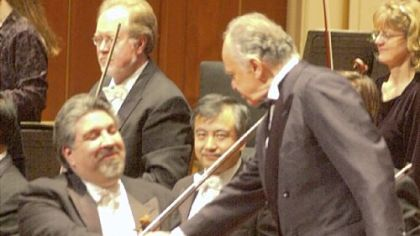 At a December 2000 concert in Heinz Hall, Mr. Cardenes greets conductor Lorin Maazel, who was instrumental in his career.