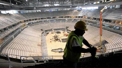 Joe Thompson of Homestead installs seats in the upper level of the new Consol Energy Center. The arena will be home to the Pittsburgh Penguins and host a range of entertainment events such as concerts and family shows.