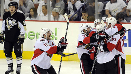 The Senators celebrate defenseman Matt Carkner's overtime goal following Game 5 at Mellon Arena, Thursday.