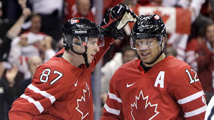Sidney Crosby congratulates Canada linemate Jarome Iginla on a goal during the 2010 Winter Olympics in Vancouver.