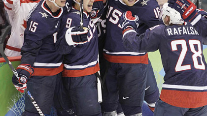 Zach Parise, 9, celebrates his goal to send the gold-medal game into overtime.
