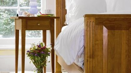 A solid cherry Summerset Bed is manufactured by Gat Creek Caperton Furniture Works in Berkeley Springs, W.Va.
