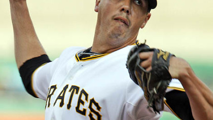 Pirates pitcher Jeff Karstens throws in the first inning.