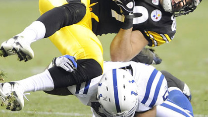 Matt Spaeth takes a hit from the Colts' Gary Bracket in a 2008 game at Heinz Field.