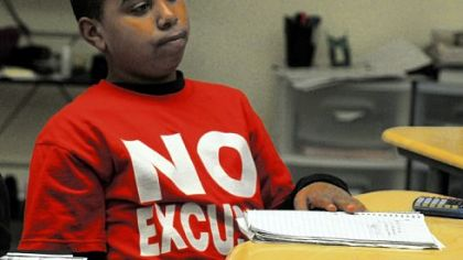 "Jonathan Williams sports his ""No Excuses"" T-shirt in his math/science class at the Propel School in McKeesport."