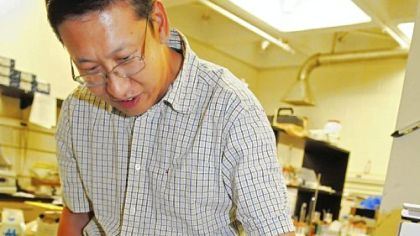 Di Gao, professor of chemical and petroleum engineering at Pitt, demonstrates his chemical filter which could help clean up the BP crude oil spill in the Gulf, he says.