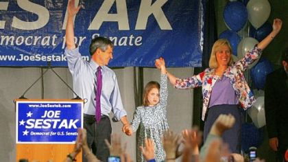 Rep. Joe Sestak with his daughter, Alex, and his wife, Susan, speaks to a primary watch event crowd in Wayne, Pa.