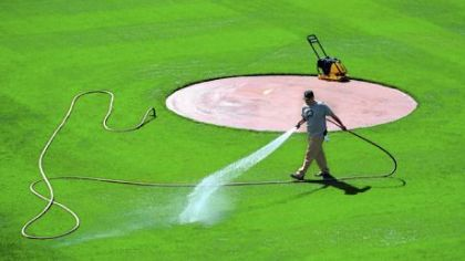Groundskeeper Matt Gerhardt waters the infield last week.