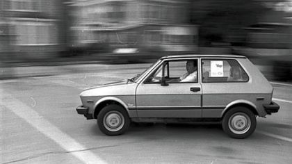 An unidentified man test drives a Yugo on the streets of Brockton, Mass. in this Aug. 27, 1985 photo.