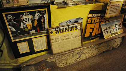Photos, plaques and a steel beam from Three Rivers Stadium. Dennis wrote notes on the beam while watching games at Three Rivers.