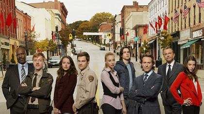 "ABC's ""Happy Town"" stars, from left, Geoff Stults, Sam Neill, Lauren German, Steven Weber, Amy Acker, Sarah Gadon, Robert Wisdom, Jay Paulson and Ben Schnetzer."