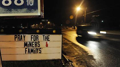 A sign outside of a gas station along Route 3 asks passersby to pray for the families of the miners caught in Massey Energy&#039;s Upper Big Branch mine explosion there killed at least 25 people, Monday.