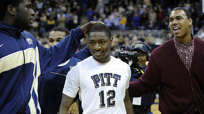 Pitt's Ashton Gibbs is congratulated by teammates.