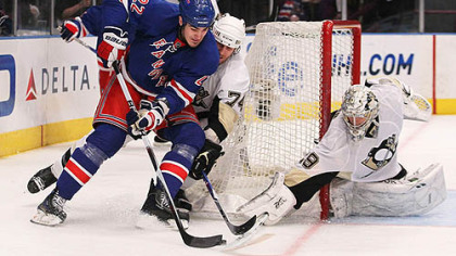 Rangers forward Brian Boyle has the puck poked away by Penguins goaltender Marc-Andre Fleury as defenseman Jay McKee gives chase.