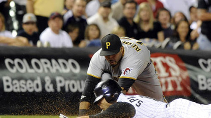 Pirates third baseman Pedro Alvarez tags out the Rockies' Ryan Spilborghs in the eighth inning.