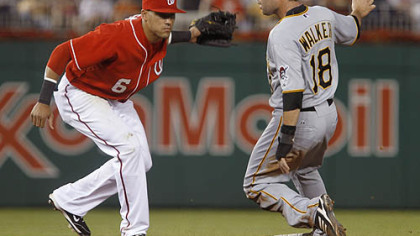 The Pirates' Neil Walker steals second base as Nationals shortstop Ian Desmond makes a late tag during the sixth inning.
