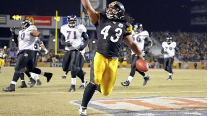 The Steelers&#039; Troy Polamalu crosses the endzone after intercepting a ball against the Ravens late in the fourth quarter of the AFC Championship at Heinz Field Sunday. The win, in a particularly violent game, sent the Steelers to Super Bowl XLIII.
