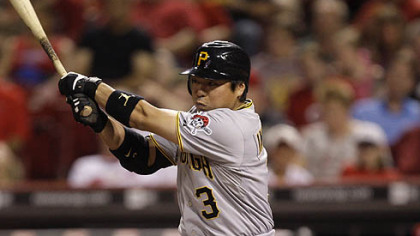 The Pirates&#039; Akinori Iwamura hits a pinch-hit single off Reds relief pitcher Enerio Del Rosario to drive in a run in the seventh inning.