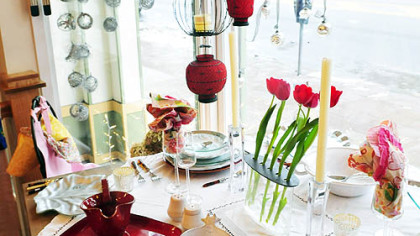 Kitchen decorations and dining utensils are arranged on a table display inside the Annex Cookery store in Homestead.