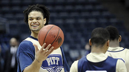 Pitt's Gary McGhee, left, plays with a ball during practice.