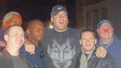 Steelers quarterback Ben Roethlisberger poses for photos with Milledgeville, Ga., police on the same night a 20-year-old college student accused the NFL star of assaulting her in a local nightclub. Pictured are left to right, Officer Paul Cressman; Lt. Willie Goddard; Sgt. Jerry Blash; Mr. Roethlisberger; Detective Everett January; and Nick Reonas, a public safety officer with Georgia College & State University.