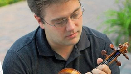 Violinst Aaron Boyd, originally from Brighton Heights, is concertmaster of Tucson Symphony.